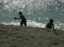 Boys Playing On The Beach